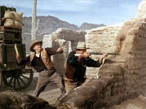 RIO BRAVO, 1959 directed by HOWARD HAWKS John Wayne (photo)