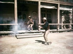 RIO BRAVO, 1959 directed by HOWARD HAWKS Ricky Nelson and John Wayne (photo)