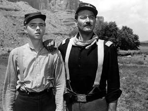 RIO GRANDE, 1950 directed by JOHN FORD Claude Jarman Jr. and John Wayne (b/w photo)