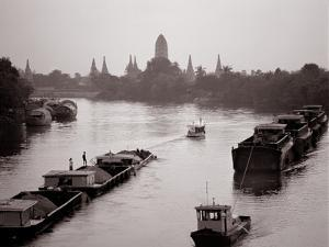 River Barges Coming Down on Chao Phraya River with a View of Wat Chaiwatthanaram, 1980