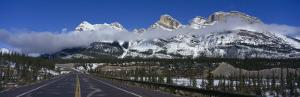 Road Leading to Snow Capped Mountains, Banff National Park, Alberta, Canada