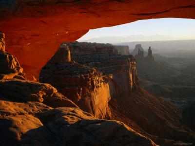 Breathtaking View Down the Canyon from a Warmly-Lit Mesa Arch by Rob Blakers