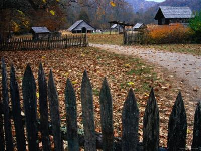 Picket Fence of Early Farm Buildings in Autumn by Rob Blakers