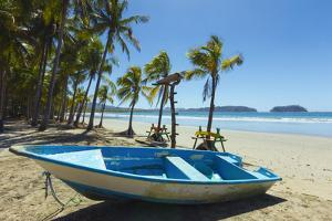 Boat on the Palm-Fringed Beach at This Laid-Back Village and Resort by Rob Francis