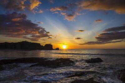 Sunset by the Southern Headland of Beautiful Playa Pelada Beach