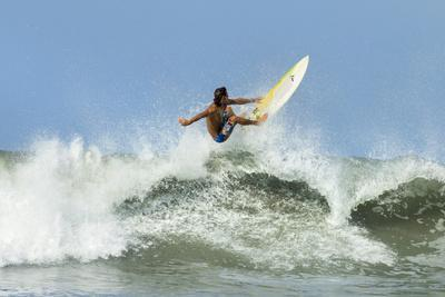 Surfer on Shortboard Riding Wave at Popular Playa Guiones Surf Beach