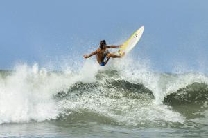 Surfer on Shortboard Riding Wave at Popular Playa Guiones Surf Beach by Rob Francis