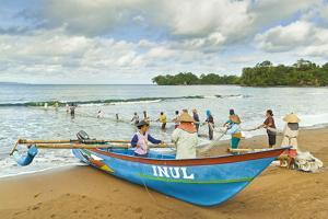 Outrigger Fishing Boat and People Pulling Net in by Hand to Shore Near Batu Karas by Rob