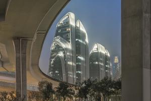 China, Jiangsu, Nanjing. Expressway and modern buildings near Nanjing South Station. by Rob Tilley