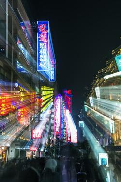 China, Shanghai. Nanjing Road, neon sign blur. by Rob Tilley