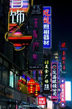 China, Shanghai. Nanjing Road neon signs. by Rob Tilley