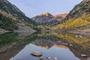 Colorado, White River National Forest, Maroon Bells with Autumn Color at First Light by Rob Tilley