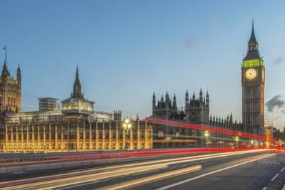 UK, London. Big Ben and Parliament Building with Traffic Trails on London Bridge by Rob Tilley