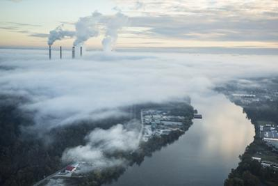 Steam and Smoke Rise from the Cooling Towers and Chimneys of a Power Plant by Robb Kendrick