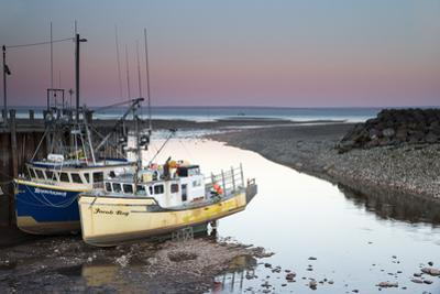 A Couple of Fishing Boats on Dry Land at Low Tide by Robbie George