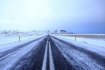 A light dusting of snow coats Iceland's Ring Road. by Robbie George