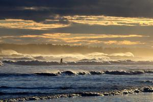 A Surfer Rides a Winter Wave Off the Coast of Maine by Robbie George