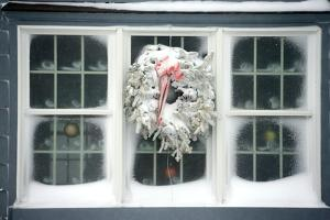A Window at Maine's Nubble Lighthouse Is Festively Decorated for Winter by Robbie George