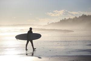 A Winter Surfer Walks Along Higgins Beach in Maine by Robbie George