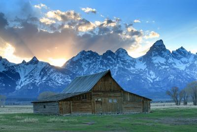 At Sunset, the Teton Range Rises Behind a Historic Barn on Mormon Row by Robbie George