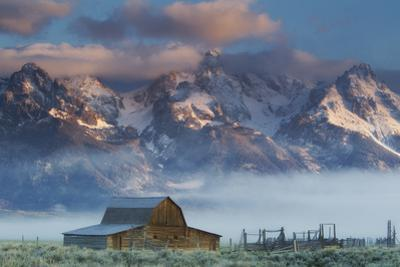 Fog Rolls in around the Mormon Row Historic District and the Snow-Capped Teton Range by Robbie George