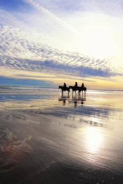 Horseback Riders on Pine Point Beach at Sunset by Robbie George