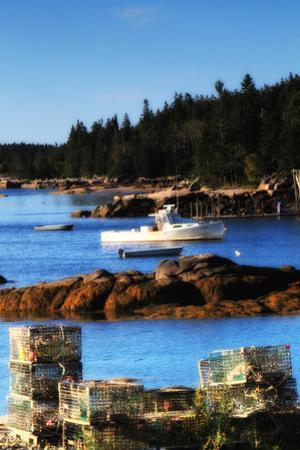 Lobster Traps Stacked on Shore, with Lobster and Row Boats Anchored Offshore by Robbie George