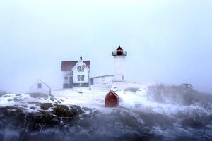 Maine's Nubble Lighthouse Shines on a Cold Winter's Day by Robbie George