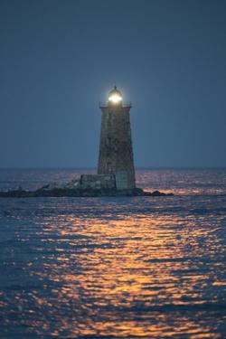 Red Moonlight Reflects Off Seawater in Front of Whaleback Lighthouse by Robbie George