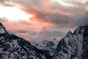 Snowy Peaks in the Teton Range under Clouds Reflecting Sunset Colors by Robbie George