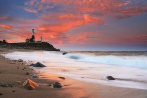 Sunset and Surf Surging onto the Beach at the Montauk Point Lighthouse by Robbie George