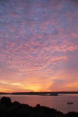 The Sun Rise over Fort Gorges and Casco Bay by Robbie George