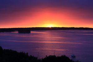 The Sun Rises over Peaks Island Off the Coast of Portland, Maine by Robbie George