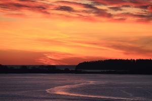 The Sun Rises over the Calendar Islands in Casco Bay by Robbie George