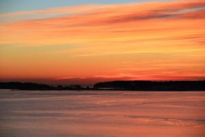 The Sun Rises over the Calendar Islands in Maine's Casco Bay by Robbie George