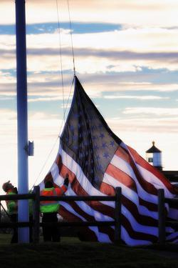Workers Raise the American Flag at the Portland Head Light by Robbie George