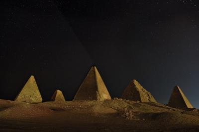 Pyramids at the Royal Cemetery next to Jebel Barkal. by Robbie Shone
