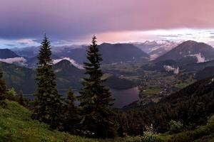 Storm Clouds Move Through the Valley as the Sun Sets over the Altaussee and the Austrian Alps by Robbie Shone