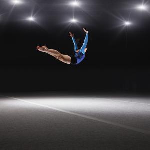 Female Gymnast Jumping through Air by Robert Decelis Ltd