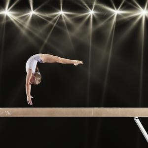 Young Female Gymnast on Balance Beam by Robert Decelis Ltd