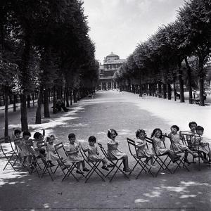 Children in the Palais-Royal Garden, c.1950 by Robert Doisneau