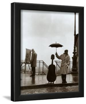 Musician in the Rain by Robert Doisneau