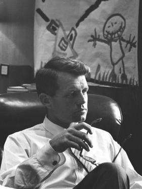 Robert F. Kennedy Sitting in Office in Front of Child's Painting