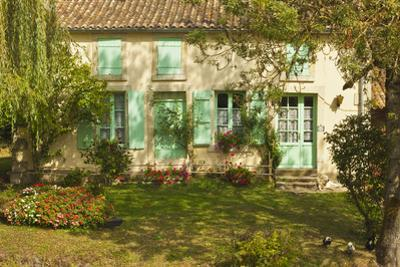 House with typical regional green shutters in the Marais Poitevin (Green Venice) wetlands, Arcais,  by Robert Francis