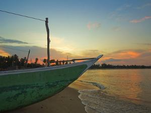 Outrigger Boat at Sunset at This Fishing Beach and Popular Tourist Surf Destination, Arugam Bay, Ea by Robert Francis