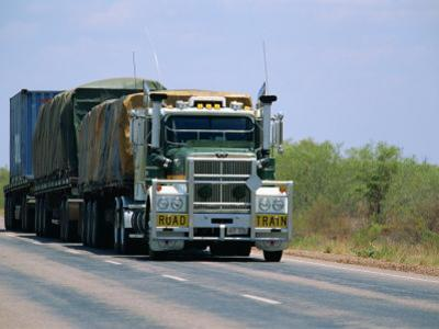 Road Train on the Stuart Highway, Northern Territory of Australia by Robert Francis