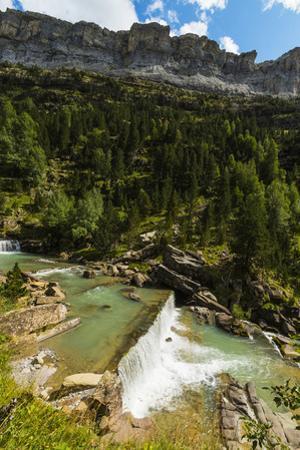 Sierra de las Cutas on the south rim above a Rio Arazas waterfall, Ordesa Valley, Ordesa National P by Robert Francis
