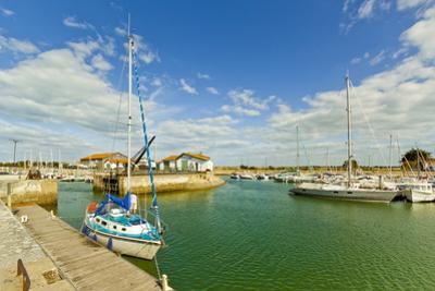 Yacht at marina by Quai de La Criee in the island's principal western town, Ars en Re, Ile de Re, C by Robert Francis