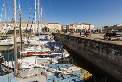 Yachts moored at the Quai de Bernonville in this north coast town, Saint Martin de Re, Ile de Re, C by Robert Francis
