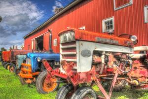 Tractors and Barn by Robert Goldwitz